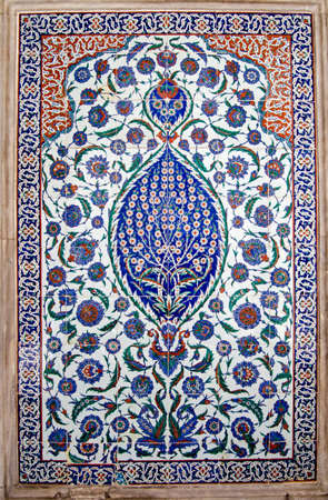 Magnificently colourful Iznik tiles decorating the exterior of the tomb of Sultan Selim II built in 1577 in the old city of Istanbul, Turkey. Stock Photo