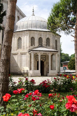 Exterior view through a rose bed of the Tomb of the Princes - children of Sultan Murad III, constructed towards the later 16th century in Istanbul, Turkey.
