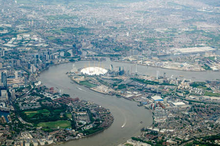 Aerial view of the River Thames at North Greenwich, London.  The millennium dome is in the centre of the image with the new arts development of City Island on the opposite side of the river.  The Excel Centre to the right hand side with the Royal Docks. At the bottom left is Mudchute.