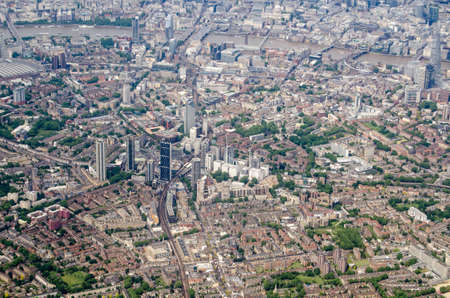 Aerial view of the London borough of Southwark with the new developments at Elephant and Castle prominent in the middle of the picture. The River Thames flows across the top with the Blackfriars bridges in the middle.