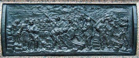 Bronze frieze depicting the Siege of Sevastopol, part of the Crimean War. Sculpted in 1904 by Henry Price and on public display on the plinth of Queen Victoria's statue at Sandhurst Military Academy, Berkshire.