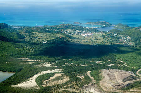 Aerial view of the Caribbean island of Antigua with the white buildings of the Antigua State College, Deep Bay Beach, Fort Barrington National Park and Galley Bay.