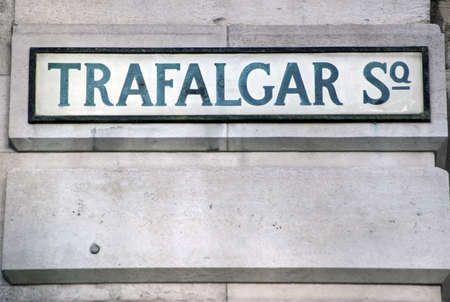 Vintage road sign on a wall beside Trafalgar Square in the centre of London.