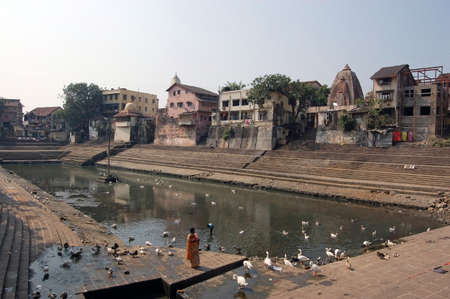 The sacred freshwater pool of Banganga Tank in the Malabar Hills district of Mumbai, formerly Bombay. The lake is sacred to Hindus and there are a number of temples surrounding the water.