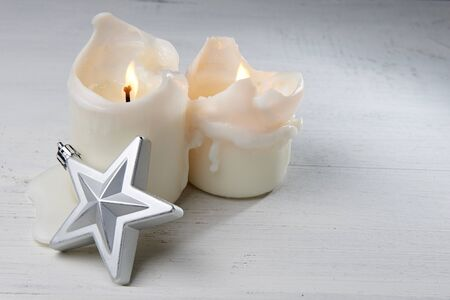 christmas candles: Christmas candles and star silver Stock Photo
