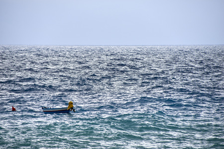 buoy: boat and buoy in rough seas