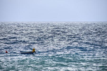 buoy: boat and buoy in rough seas