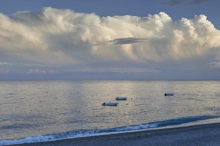 threaten: beach and boats at sunset Stock Photo