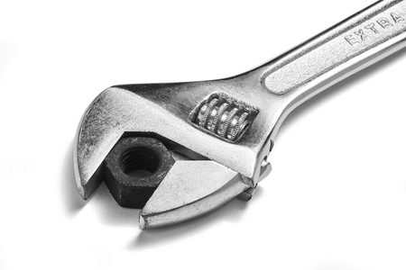 wrench with nut on a white background