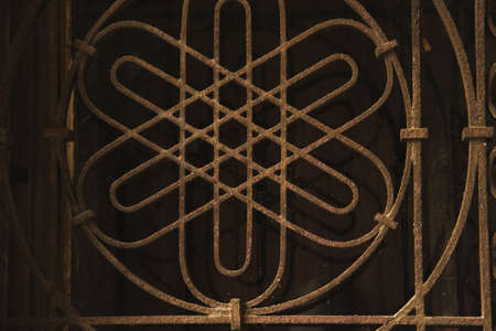 Close up of a window with metal lattice