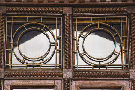 Old wooden windows with metal bars