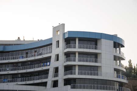 Hotel facade. Blue and cream color of facade