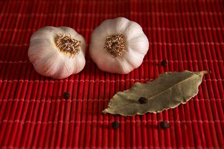 Garlic, onion, bay leaf, black pepper on a wooden table. Garlics. sliced garlic, garlic clove, garlic bulb