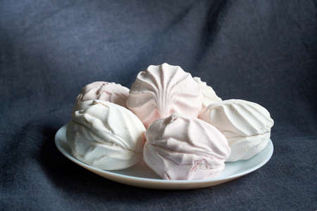 food, confection and sweets concept - close up of zephyr or marshmallow dessert Stok Fotoğraf