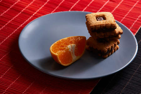 Group of chocolate Halloween cookies on plate and red and black