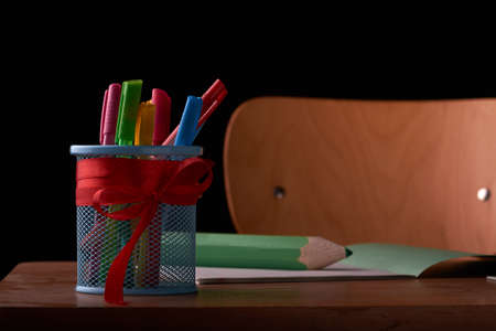 back to school concept and holder for pens on school desk isolated Stok Fotoğraf