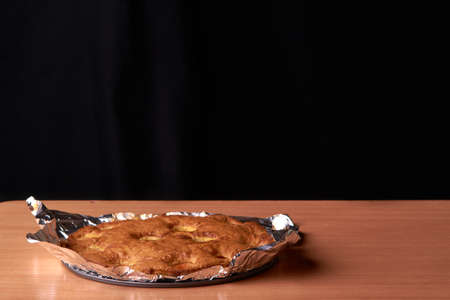 Apricot baked in foil on a wooden table Stock Photo