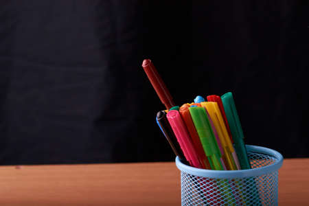 Color Magic in a metal box on a black background in classroom