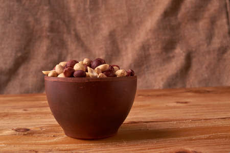 walnut peanut in clay bowl. peanuts for food textures. peanut harvest. fried peanuts. texture of the nuts.