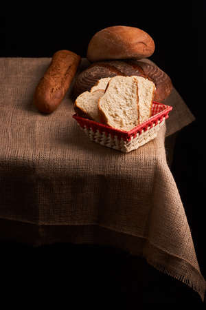 Bakery - gold rustic crusty loaves of bread and buns on black chalkboard background 版權商用圖片