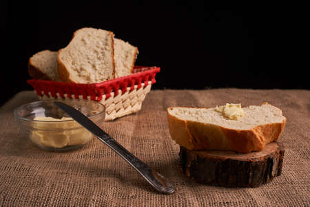 Bakery - gold rustic crusty loaves of bread and buns on black chalkboard background Imagens