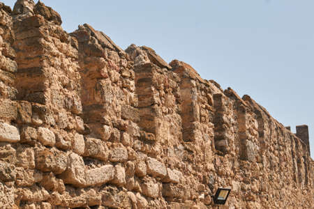 Fragment of the old wall made of the castle