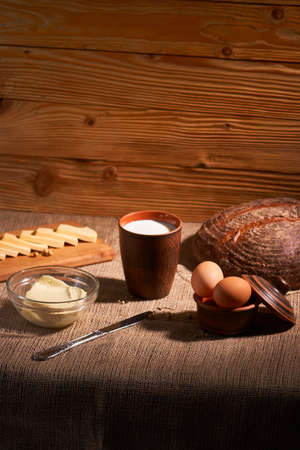 Assorted dairy products milk, cheese, butter rustic still life