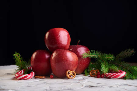 Candy and apples on the wooden background. New year food Stock Photo
