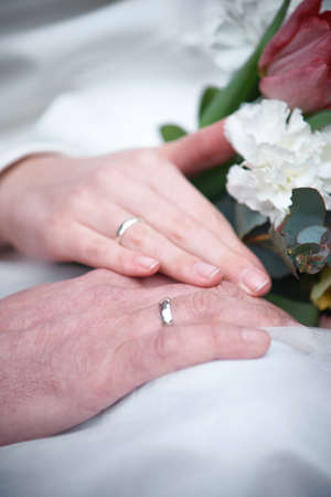 happy wedding day. Loving couple holding hands with rings. Stock Photo