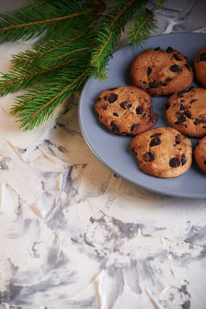 sweet homemade cookies with chocolate chip on white background on the plate Stock Photo