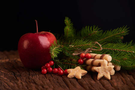 Christmas Holiday Eating Concept. apple and cooking on the wooden background.