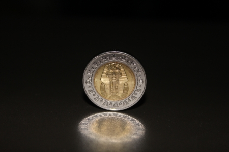 Egyptian coin featuring Pharaoh photo