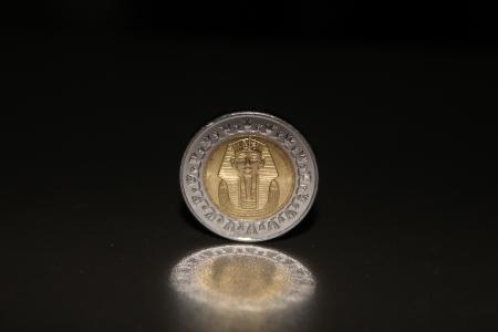 tutankhamen: Egyptian coin featuring Pharaoh