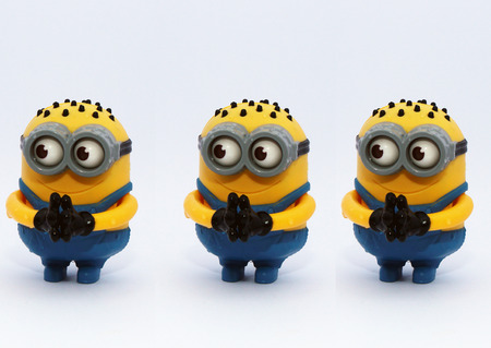 conjunction: Cairo, Egypt - August 3, 2015: Minions Figurine issued with McDonalds Happy Meals in 2015. The toys are issued in conjunction with Happy Meal Purchases to promote the release of the Minion movie.Minions toy an action figure from Despicable Me 2 animated 3