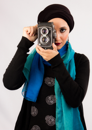 broach: Vintage portrait of Arabic Young woman with high fashion dark make up wearing veil, scarf and fashion earrings  Veiled Young Woman in dark make up and scarf  Vintage portrait of woman