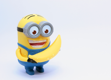 Minion Figurine  Cairo, Egypt - August 15, 2015: Minion Figurine issued with McDonalds Happy Meals in 2015. The toys are issued in conjunction with Happy Meal Purchases to promote the release of the Minion movie