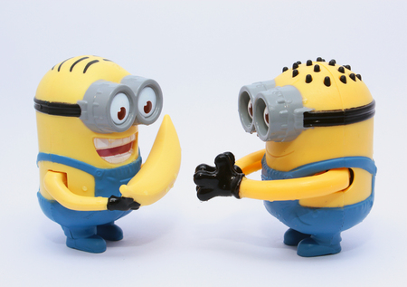 conjunction: Minion Figurine  Cairo, Egypt - August 15, 2015: Minion Figurine issued with McDonalds Happy Meals in 2015. The toys are issued in conjunction with Happy Meal Purchases to promote the release of the Minion movie