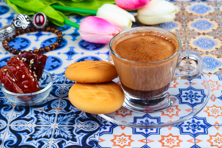 original plate: Cup of Arabian Coffee on an Oriental Colorful Background  Cup of Espresso on an Oriental Colorful Background with Flowers, Rings, and Tamr dates