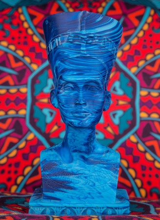 Ancient Egyptian Pharaoh Statue on colorful Artistic background  Ancient Egyptian pharaoh Statue on colorful oriental pattern