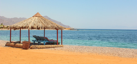 monte sinai: Cottage in a Camp in Sinai, Taba desert with the Background of the Sea and Mountains.