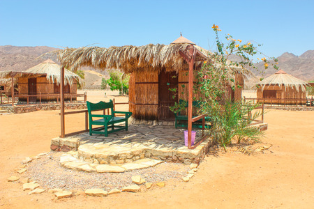 sinai desert: Cottage in a Camp in Sinai, Taba desert with the Background of the Sea and Mountains.