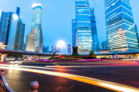 shanghai downtown at night with roundabout light trails photo