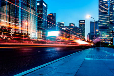blur: The light trails on the modern building background in shanghai china. Stock Photo