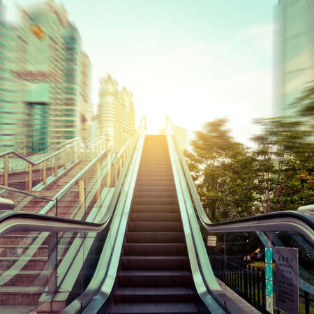 view of a staircase in a shop: escalator in the outdoor under the sky, urban abstract landscape Stock Photo