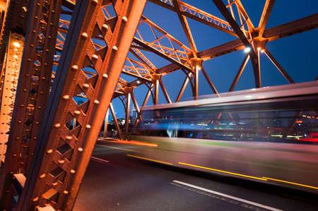 traffic through bridge with blur trail