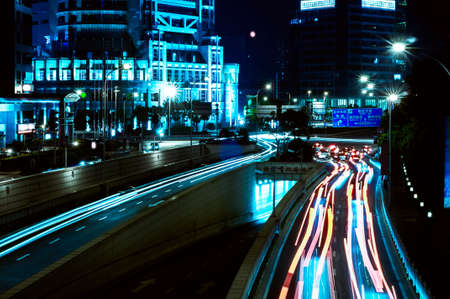 shanghai downtown at night with roundabout light trails Stock fotó