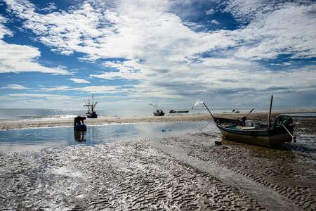 blanket fish: fisherman and boat
