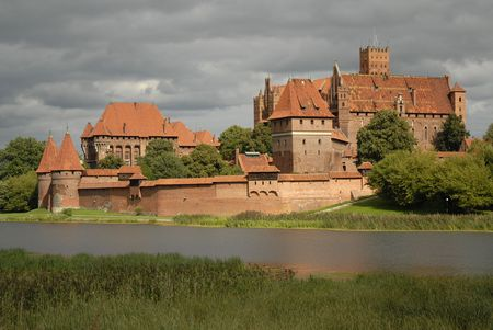 eventually: Malbork castle from opposite river bank eventually highlighted with the sun Stock Photo