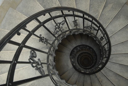 Spiral staircase with forged railing photo