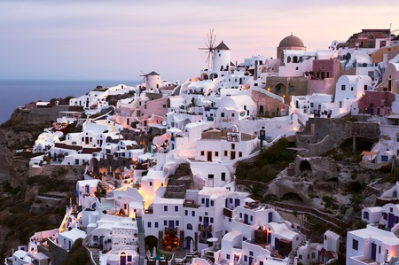 fira: Oia village at sunset, Santorini, Greece Stock Photo